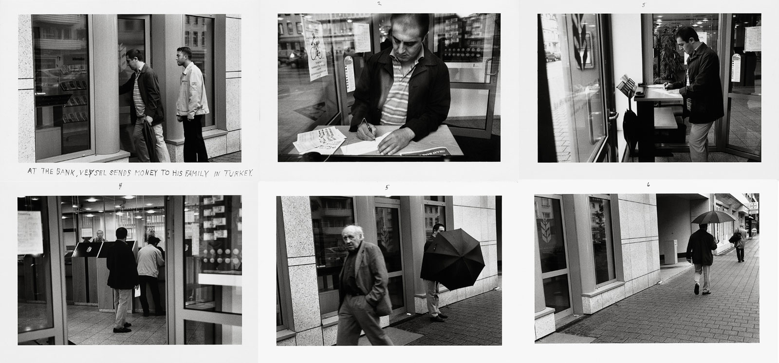 AT THE BANK, VEYSEL SENDS MONEY TO HIS FAMILY IN TURKEY., Duisburg, 2001